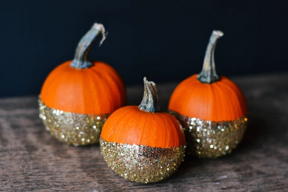 Go glam this fall by decorating your pumpkin with glitter using a dip-dyed look that will carry over from Halloween to Thanksgiving.