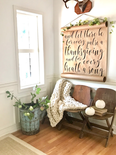 Rustic farmhouse entryway with beautiful Thanksgiving decor