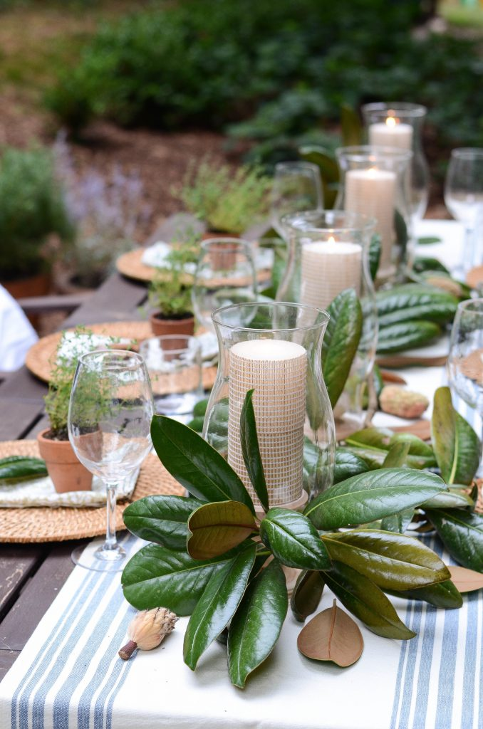 Outdoor Thanksgiving decor inspiration using greenery and candles